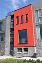Modern Dutch home with red facade in Leiden Stock Images
