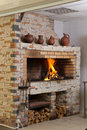 Modern eclectic fireplace a brick decorated with crocks Royalty Free Stock Images
