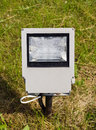 Modern electric lamp on city park field halogen grass Stock Photos