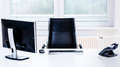 Modern empty office space desk with computer, phone and chair. Royalty Free Stock Photo
