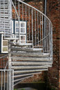 Modern exterior spiral staircase of metal in the backyard on an Royalty Free Stock Photo