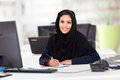 Modern female arabian office worker office Stock Images