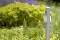 Modern garden lamp on green background Royalty Free Stock Image
