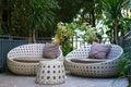 Modern garden sofa or love seat in the home garden Stock Images