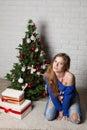 Modern girl near christmas tree new year s Stock Photography