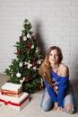 Modern girl near christmas tree teenager and fancy box Stock Photo