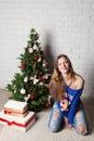Modern girl near christmas tree teenager smiling and fancy box Stock Photo