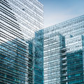 Modern glass skyscraper closeup exterior of blue curtain wall with abstract space Stock Photo