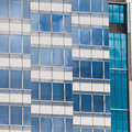 Modern glass-walled highriser building facade Royalty Free Stock Photo