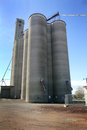 Modern grain elevator a large busy to load trucks with in eastern washington under clear blue skies Royalty Free Stock Images