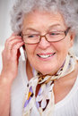 Modern grandma talking on a cellphone Royalty Free Stock Photo