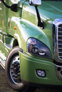Modern green rig semi truck details like fency big transport Royalty Free Stock Photo