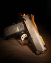 Modern handgun semi automatic that is on a dark rubber background Royalty Free Stock Images