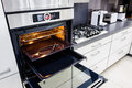 Modern hi-tek kitchen, oven with open door