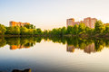 Modern high-rise apartment buildings by the lake at sunset Royalty Free Stock Photo