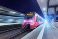 Modern high speed red passenger train at night