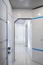 Modern home hallway interior. White plactic panels and tiles. Futuristic interior concept design. Space ship at home. Royalty Free Stock Photo