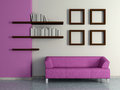 Modern home interior with sofa book shelves violet magenta near the wall and four paintings d Stock Images