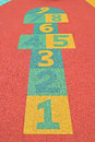 Modern hopscotch game colorful at children playground with protective rubber surface Royalty Free Stock Photo