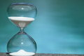 Modern hourglass symbol of time countdown sand trickling through the bulbs a crystal sand glass management timer Stock Photography