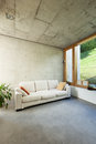Modern house in cement beautiful interiors room with divan Royalty Free Stock Photo