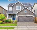 Modern house with gray exterior and blue white trim Royalty Free Stock Photos