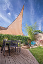 Modern house terrace in summer with shade sail table and Stock Photography