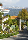 Modern house white in buyukada island turkey on a slope alley bosporus channel in the background Stock Photos