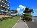 Modern housing complex with sidewalk at river Royalty Free Stock Photo