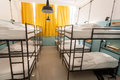 Modern interior of dormitory room with bunk beds in new hostel style for many students Royalty Free Stock Photo