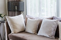 Modern interior pillows on brown sofa Royalty Free Stock Photo