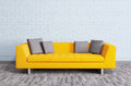 Modern interior with sofa d render orange over the brick wall Royalty Free Stock Image