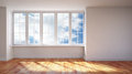 Modern interior sunlit empty room Royalty Free Stock Photos