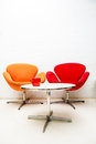 Modern interior table with coffee cup and two chairs Royalty Free Stock Photo