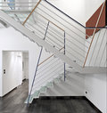 Modern iron staircase detail of a overlooking on the corridor in the workspace Stock Photos