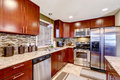 Modern kitchen interior with mosaic back splash trim and granite bright wooden cabinets steel appliances blend perfectly tops Stock Photos