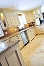Modern kitchen with tile floor Stock Photo