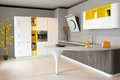 Modern kitchen white and yellow coloured wide visual of a Royalty Free Stock Photos
