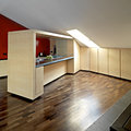 Modern kitchen wood furniture in a in the attic with wood floor Royalty Free Stock Image