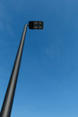 Modern LED street lamp post against a blue sky Royalty Free Stock Photo
