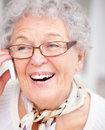 Modern Lifestyle - grandma talking on a cellphone Stock Photos