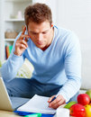 Modern lifestyle - Man paying bills over phone Royalty Free Stock Photography