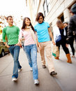 Modern Lifestyles - Three friends walking Stock Image