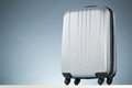 Modern lightweight suitcase a gray with wheels Royalty Free Stock Images