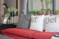 Modern living room design with pillows on the red sofa Royalty Free Stock Photo