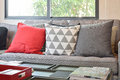 Modern living room design with red and gray pillows on sofa Royalty Free Stock Photo