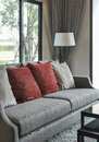 Modern living room design with red pillows on sofa Royalty Free Stock Photo