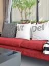 Modern living room design with white pillows on red sofa Royalty Free Stock Photo