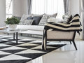 Modern living room interior with black and white checked pattern pillows and carpet Royalty Free Stock Photo