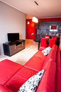 A modern living room with red decorations and colors Royalty Free Stock Photography